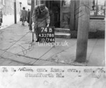 SK378874B, Man marking Ordnance Survey minor control revision point with an arrow in 1940s Sheffield