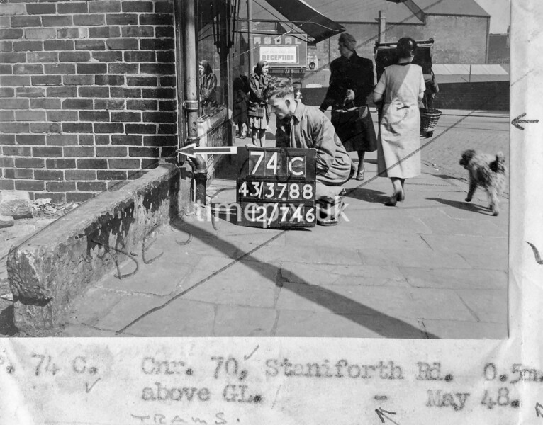 SK378874C, Man marking Ordnance Survey minor control revision point with an arrow in 1940s Sheffield