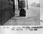 SK378823B, Man marking Ordnance Survey minor control revision point with an arrow in 1940s Sheffield