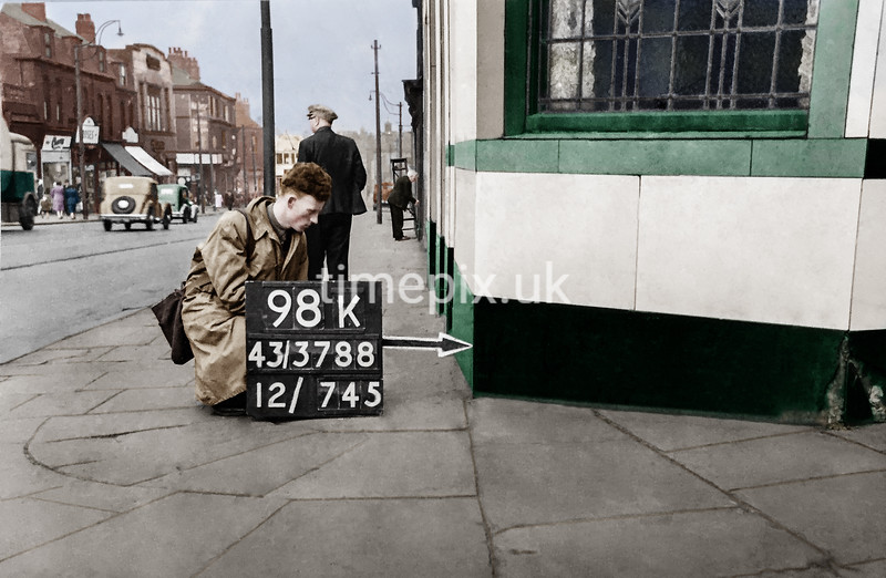 SK378898K, Man marking Ordnance Survey minor control revision point with an arrow in 1940s Sheffield
