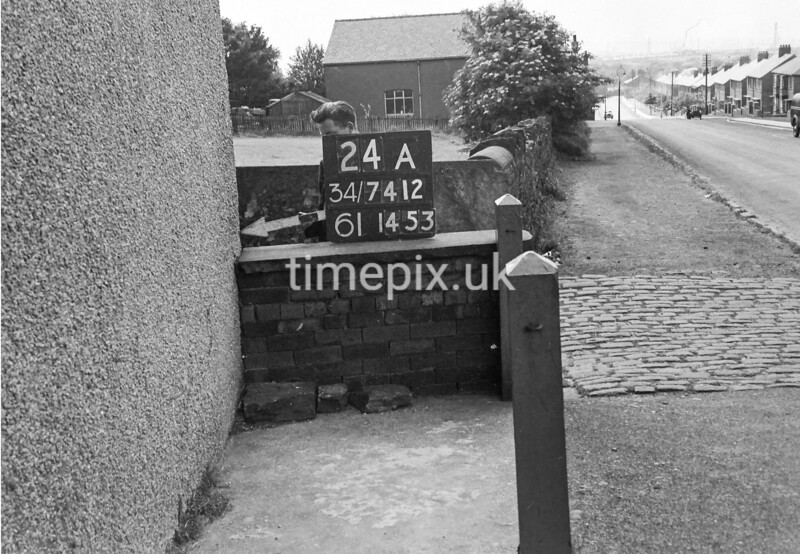 SD741224A1, Man marking Ordnance Survey minor control revision point with an arrow in 1950s