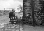 SD741224A2, Man marking Ordnance Survey minor control revision point with an arrow in 1940s