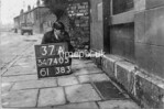 SD740537A1, Man marking Ordnance Survey minor control revision point with an arrow in 1940s