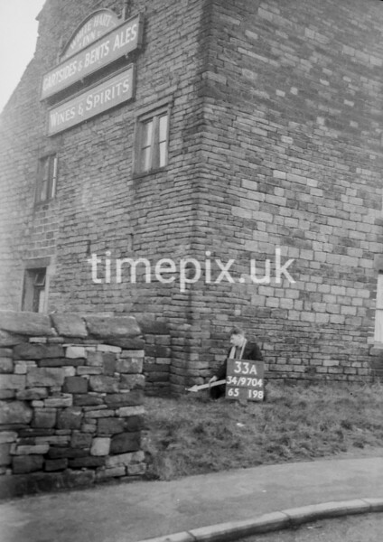 SD970433A, Man marking Ordnance Survey minor control revision point with an arrow in 1950s