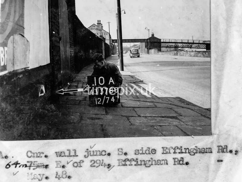 SK378810A, Man marking Ordnance Survey minor control revision point with an arrow in 1940s Sheffield