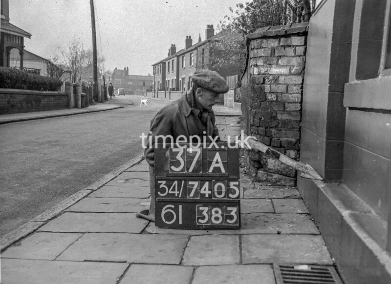 SD740537A, Man marking Ordnance Survey minor control revision point with an arrow in 1940s