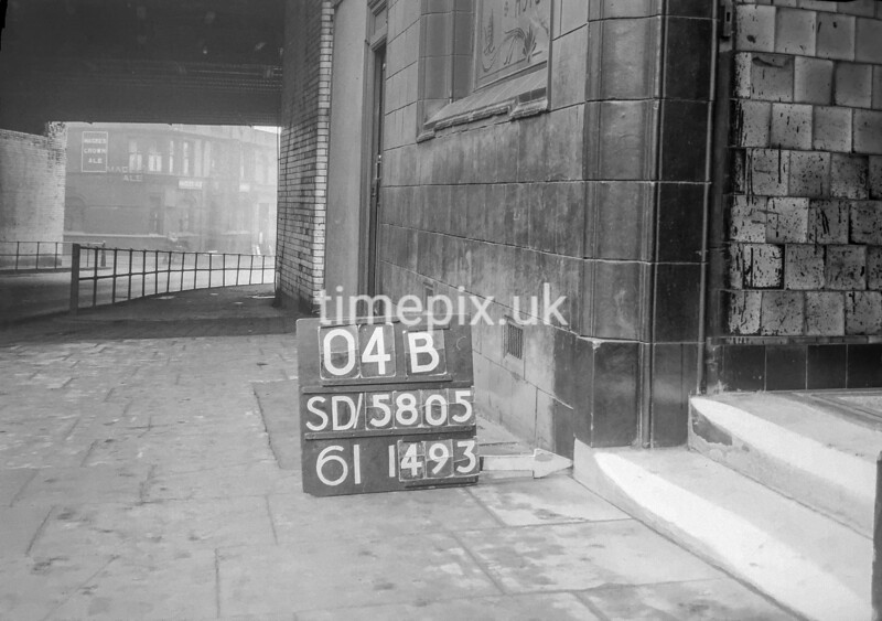 SD580504B, Man marking Ordnance Survey minor control revision point with an arrow in 1950s