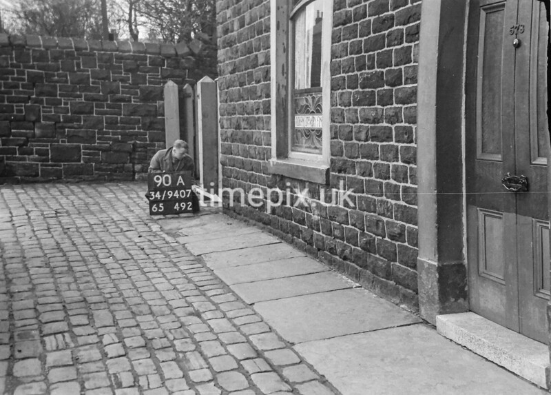 SD940790A, Man marking Ordnance Survey minor control revision point with an arrow in 1950s