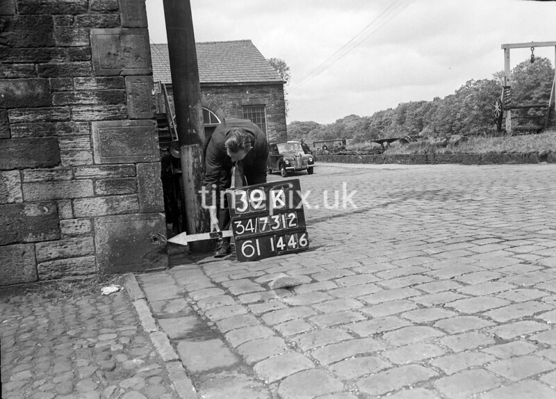 SD731239K, Man marking Ordnance Survey minor control revision point with an arrow in 1950s