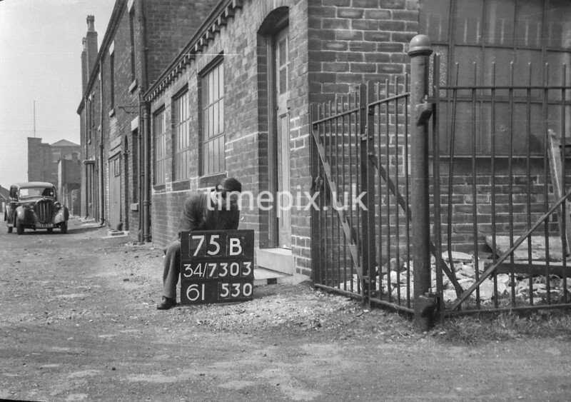 SD730375B, Man marking Ordnance Survey minor control revision point with an arrow in 1940s