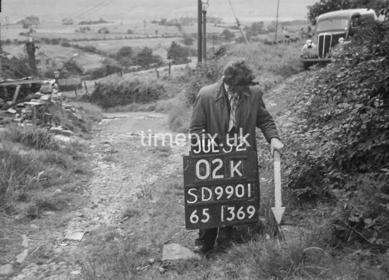 SD990102K, Man marking Ordnance Survey minor control revision point with an arrow in 1950s