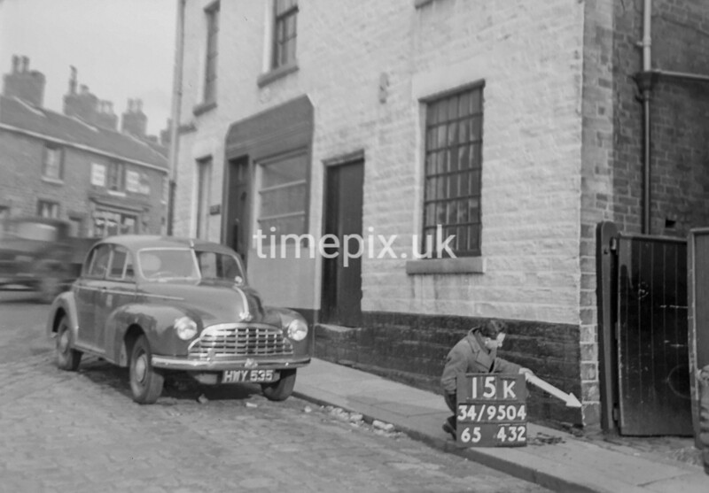 SD950415K, Man marking Ordnance Survey minor control revision point with an arrow in 1950s