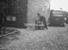 SD720088A, Man marking Ordnance Survey minor control revision point with an arrow in 1950s
