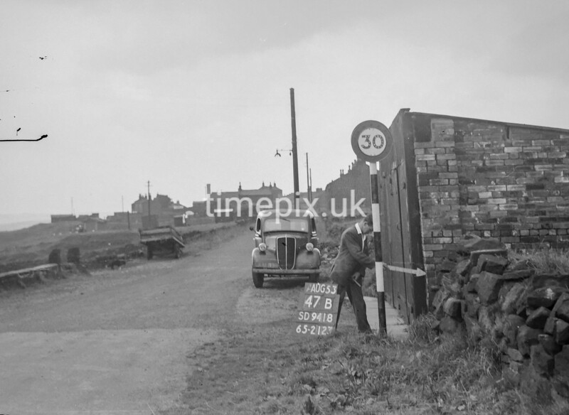 SD941847B, Man marking Ordnance Survey minor control revision point with an arrow in 1950s