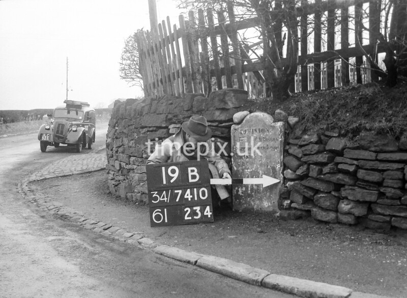 SD741019B, Man marking Ordnance Survey minor control revision point with an arrow in 1940s