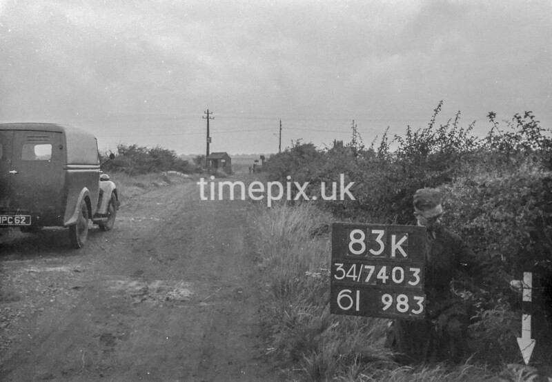 SD740383K, Man marking Ordnance Survey minor control revision point with an arrow in 1940s