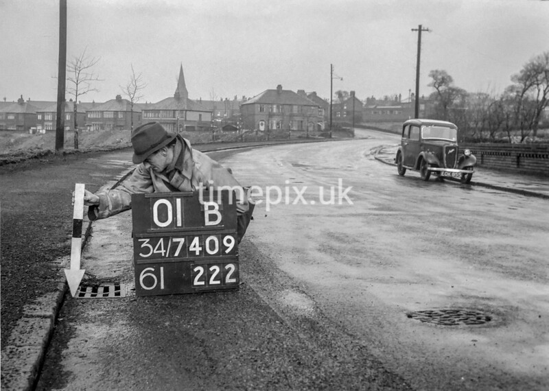 SD740901B, Man marking Ordnance Survey minor control revision point with an arrow in 1940s