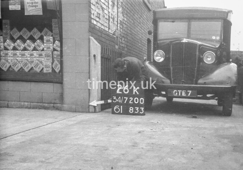 SD720026K, Man marking Ordnance Survey minor control revision point with an arrow in 1950s