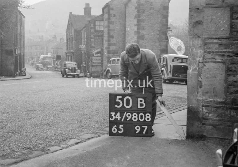 SD980850B, Man marking Ordnance Survey minor control revision point with an arrow in 1950s