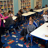 Karen Comer gives instructions to the class about Smart Money.