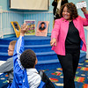 Karen Comer points to a student to answer a question.