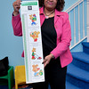 Karen Comer holding a Grow With Your Money Growth Chart.