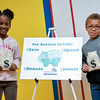 Mariah Crosby and Malcolm Bolden received a money bag as a gift for attending the Smart Money Day event.