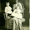 Esther and Mark's first 2 daughters, Pansy and Virginia, sitting on their grandmother Jennie's lap. 1916.