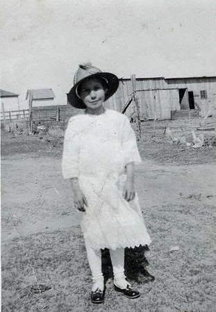 Esther Smith on their farm in Lenore, Kansas.  Her father, CM Smith also owned and operated a success buchering business.  Grammy said she missed the plains of Kansas when they moved to Colorado when she was 11.  She felt closed in by the mts.  when Esther was in her 80s, Aunt Marge took her back and Grammy remembered all the streets and places and even ran into her childhood boyfriend and some relatives and they had a great chat!