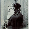 Esther sitting on her mother, Jennie Norlin-Smith, lap in Lenore Kansas.