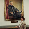 Marvel Bramwell standing in front of the oil portrait of Dr George Norlin, within the Norlin LIbrary at Univ of Colo-Boulder. He was President for 25 years.  He is her great-great uncle.  The library at Boulder is named after him. (photo 1983)