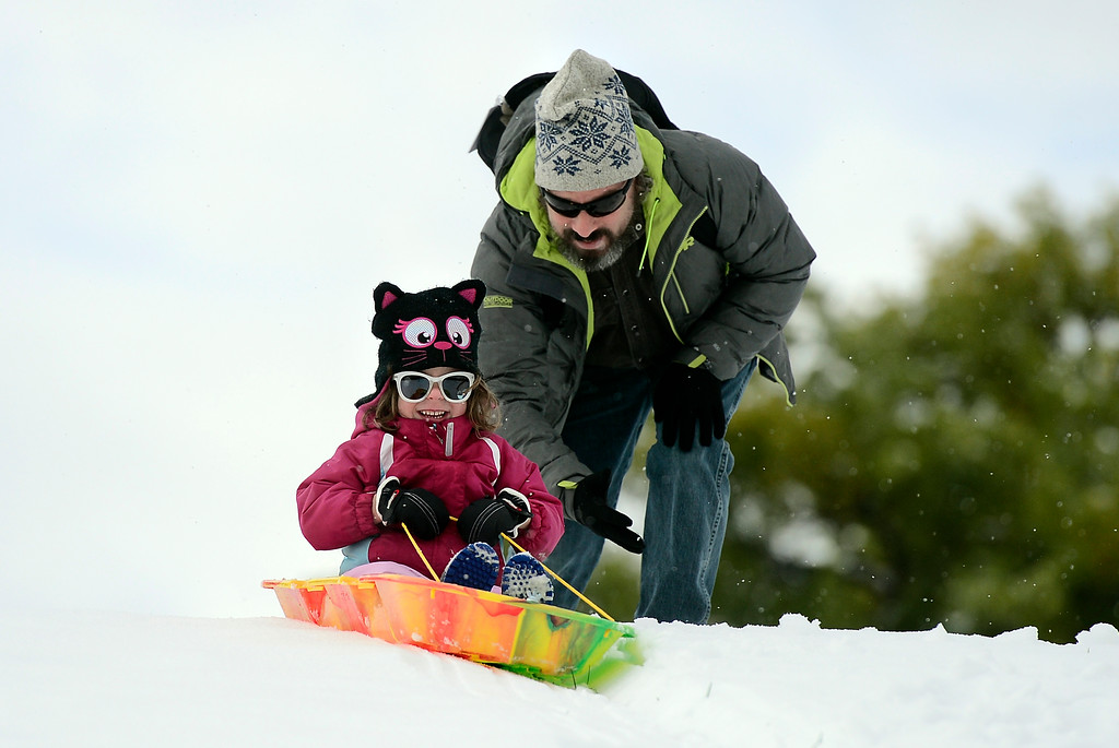 . Jeff Lessem, and his daughter Lucy, 4, have fun sledding at Scott Carpenter Park on Monday in Boulder. Jeremy Papasso/ Staff Photographer 10/09/2017