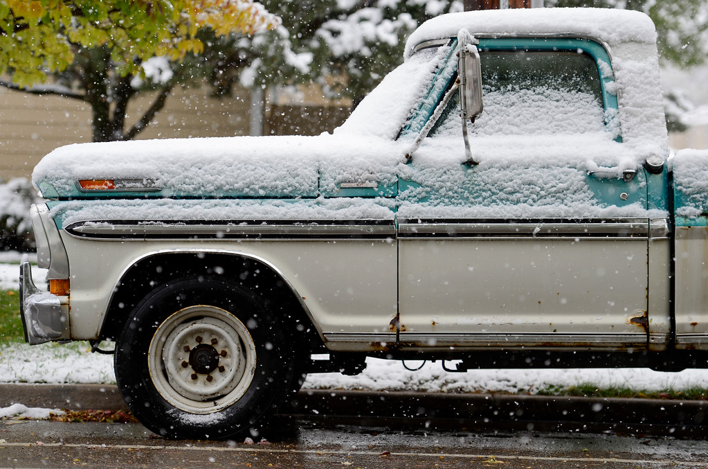 . Snow covers a pickup truck parked on Marin Street in Longmont Colorado on Oct. 9, 2017.  (Photo by Matthew Jonas/Times-Call)