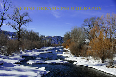 The Yampa River in winter . Near the town of Steamboat this river was fast flowing and beautiful. The fresh snow still lived on some of the boulders in the river. I have to get back at different times of the day.