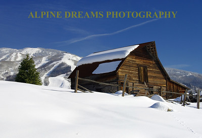 This is a famous Barn near the town of Steamboat. The snow was up to my waist where I stomped out a spot for my mono-pod to get this shot. The evergreen, the ski area, the blue sky, the afternoon sun, the rocks, the fresh snow, the faded jet trail and especially the old Barn and weathered fence makes this one of my favorite planned shots ever. Now I have to go back for different seasons.