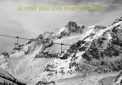 I shot this in B&W for a dramatic effect   The mountains  The glacier   the off-piste leave a great background for the  chairs.