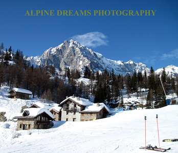 This is a memory I will take home with me   The  buildings  the mountains  the snow  the skis     life is good!