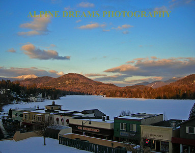 The sun was setting in downtown lake placid. The shadows spilled across Mirror lake. Check out the mountains in the background.
