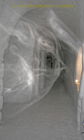 This eerie picture is not doctored up. It was taken inside the famous Ice Hotel up on the mountain. The misty streams of fog gave this hallway a ghostly quality. I am just glad it showed up in the picture.i
