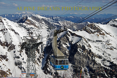 BLUE TRAM OF SNOWBIRD ABOVE THE PEAKS