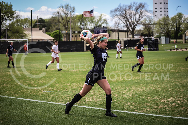 Sophomore defender Alyiah El-Naggar throwing the ball in from the sideline on Saturday's game (April 10, 2021) against Iowa State at Busser Family Park Stadium.<br /> Elizabeth Proctor Collegian Media Group