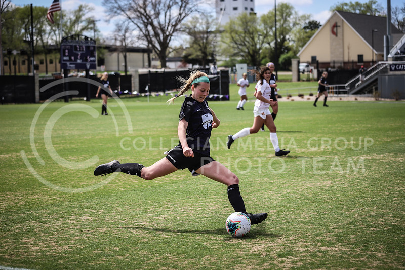 Sophomore defender Alyiah El-Naggar kicking the ball down the field on Saturday's game (April 10, 2021) against Iowa State at Busser Family Park Stadium.<br /> Elizabeth Proctor Collegian Media Group