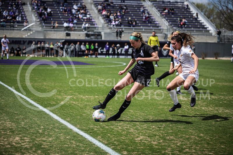 Sophomore defender Aliyah El-Naggar dribbling the ball on Saturday's game (April 10, 2021) against Iowa State at Busser Family Park Stadium.<br /> Elizabeth Proctor Collegian Media Group
