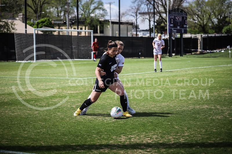 Senior midfielder Brookelynn Entz defending the ball on Saturday's game (April 10, 2021) against Iowa State at Busser Family Park Stadium.<br /> Elizabeth Proctor Collegian Media Group