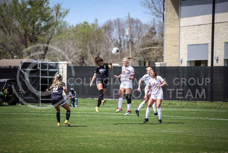 Senior midfielder Brookelynn Enez heading the ball on Saturday's game (April 10, 2021) against Iowa State at Busser Family Park Stadium.<br /> Elizabeth Proctor Collegian Media Group