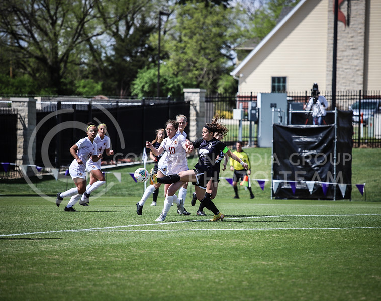 Senior midfielder Brookelynn Enez keeping the ball away from Iowa on Saturday's game (April 10, 2021) against Iowa State at Busser Family Park Stadium.<br /> Elizabeth Proctor Collegian Media Group