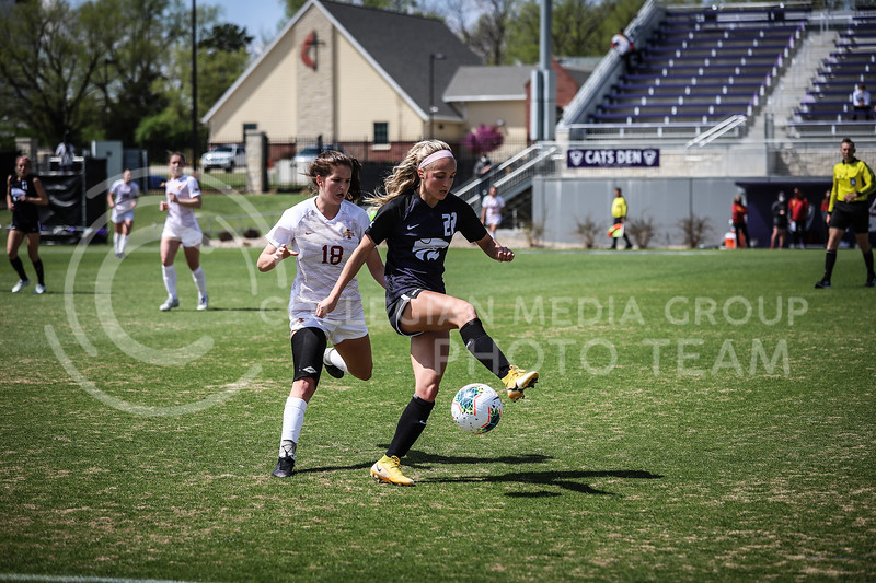 Freshman forward Maddie Weichel dribbling the ball down on Saturday's game (April 10, 2021) against Iowa State at Busser Family Park Stadium.<br /> Elizabeth Proctor Collegian Media Group