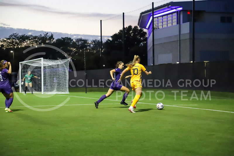 Senior defender Emily Crain battles for the ball with a West Virginia player. Kansas State and West Virginia played on October 7, 2021 at Busser Family Park. Madison Riebel   Collegian Media Group)