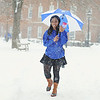 Dakota Walker '17 walks across campus in the snow.