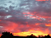 7/18/12  Crazy sunset Santa Clarita...  Blury area just above the bright yellow, middle to left, is rain pouring down!